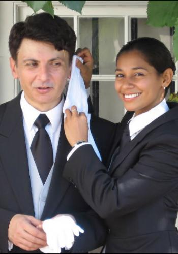 Christian Leo Miza from Rumania and Arceli Rivero from Belize - Graduates of The International Butler Academy